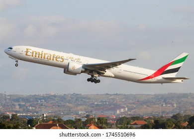 Denpasar, Bali/Indonesia-1 August 2019: Emirates Airlines Boeing 777-300ER (A6-EBU) leaving I Gusti Ngurah Rai International Airport