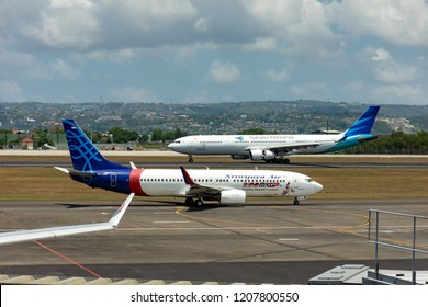Denpasar, Indonesia - September 19, 2018: Sriwijaya airplane taxiing at tarmac in Bali Ngurah Rai international airport. It is Indonesia's third largest carrier.