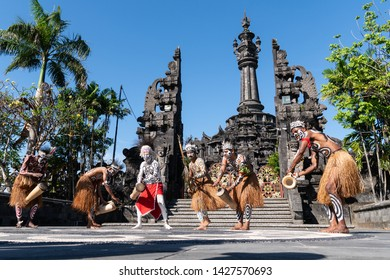 DENPASAR/BALI-JUNE 15 2019: Papuan tribe dancers are preparing for a performance at the Bali Arts Festival 2019 (Pesta Kesenian Bali). This is a public and free event