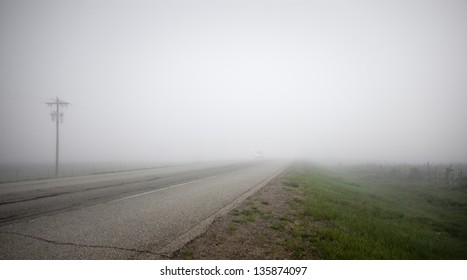 Dense fog covers a highway in rural New Mexico.