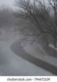 Dense fog over the icy Kishwaukee River in Illinois