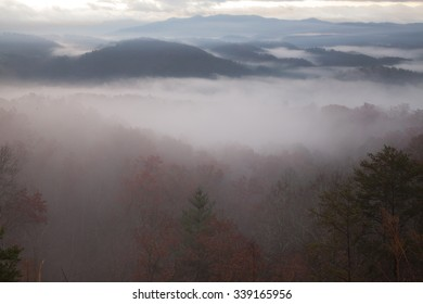 dense morning fog drapes smoky mountains valleys