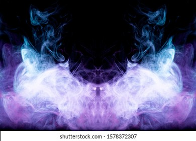Dense multicolored smoke of blue and purple colors in the form of a skull, monster, dragon on a black isolated background. Background of smoke vape. Mocap for cool t-shirts