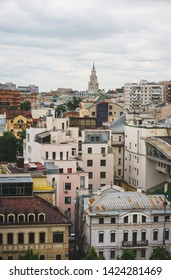 Dense urban development in the capital of Russia, Moscow. Streets and districts of the city view from above. Cityscape and skyline. Summer in Moscow.