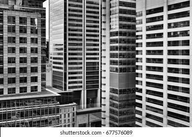 Densely constructed high-rise buildings in Sydney city CBD in black-white. High concentration of business offices and headquarters reflecting busy modern life