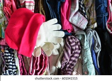 Densely packed children's things, Hat and gloves