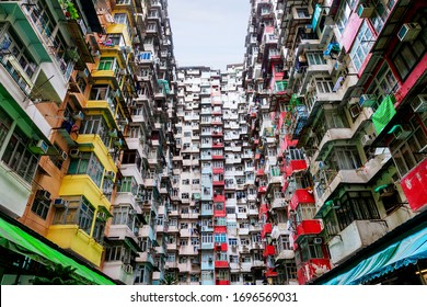 "Densely populated housing in the old residential district of Quarry Bay, Hong Kong. Nicknamed ""Monster Building,"" the interconnected apartments have become a popular tourist attraction."