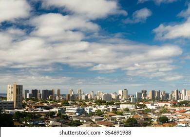 Densely situated homes and buildings exist in Honolulu on the island of Oahu