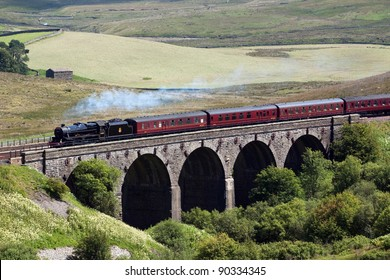 DENT HEAD, ENGLAND - JULY 24: Preserved steam locomotive 45407 heads the Waverley over Dent Head Viaduct on July 24, 2011, on the Settle to Carlisle railway.
