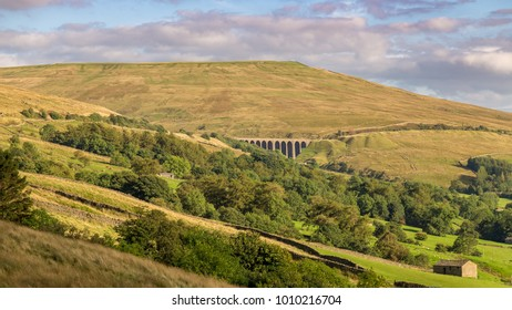The Dent Head Viaduct on the Settle-Carlisle Railway, seen from Cowgill in the Yorkshire Dales, North Yorkshire, UK