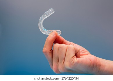 Dental aligner used by dental doctors isolated on blue background.