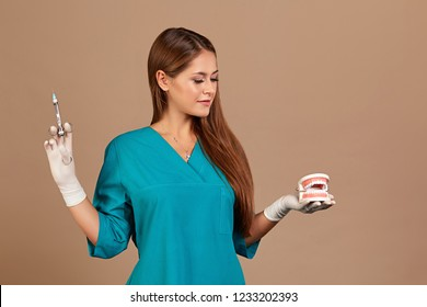Dental anesthesia or puncture cyst tooth concept photo. Doctor dentist holding syringe, pursuing dental anesthesia procedure, cyst puncture