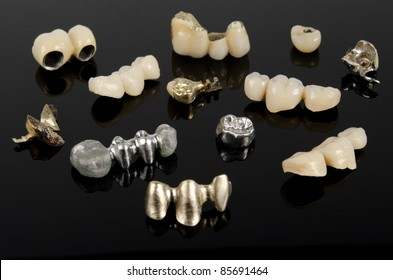 dental bridges and crowns on black acrylic