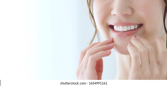 Dental care concept of a young asian woman.