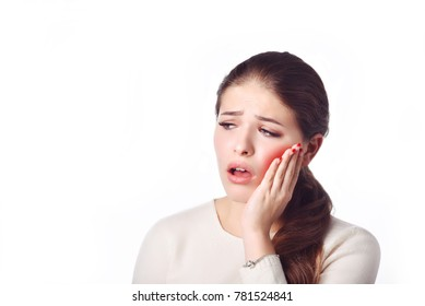 Dental care and toothache.Teeth Problem. Woman Feeling Tooth Pain. Closeup Of Beautiful Sad Girl Suffering From Strong Tooth Pain. Attractive Female Feeling Painful Toothache. Dental Health And Care