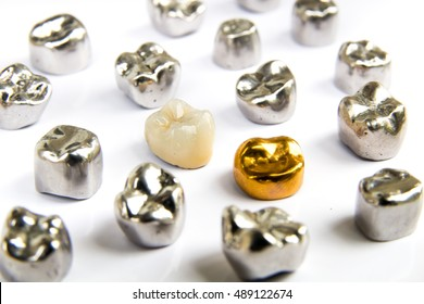 Dental ceramic, gold and metal tooth crowns on white background. Isolated.