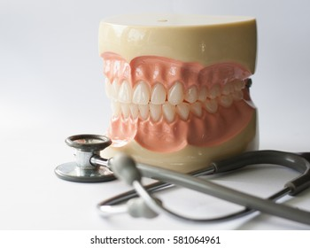 Dental concept. Photographs of jaws Model dental and medical equipment, white background. Closeup.