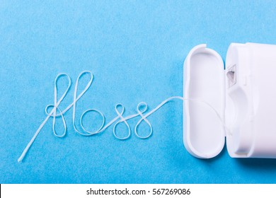 Dental floss word written in letters of floss on a blue background