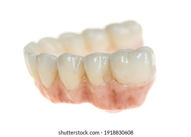 Dental health care. Ceramic zirconium in final version. Close up dental prosthesis on zirconium oxide implants, isolated on white. Side view