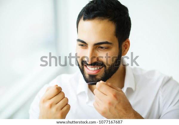 Dental Health Man Beautiful Smile Flossing Stock Photo Edit Now 1077167687