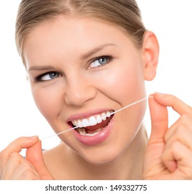 Dental hygiene woman cleaning teeth with floss, isolated over white background. Young attractive blonde with white toothy smile.