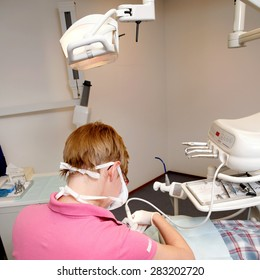 the dental hygienist working in her dentist's office