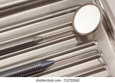 Dental instruments are lying in a medical tray. Healthy lifestyle.