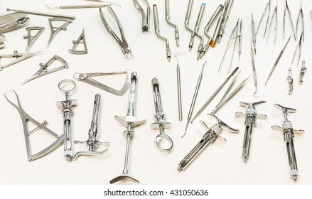 Dental instruments for stomatology practice. Tweezer, carver, wiper, drill, pincers, scraper, remover.