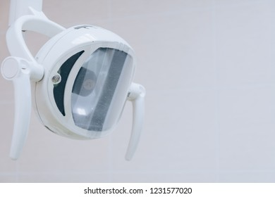 Dental light close up in dentist office. Dental clinic equipment - close up image of medical exam light. White tone.