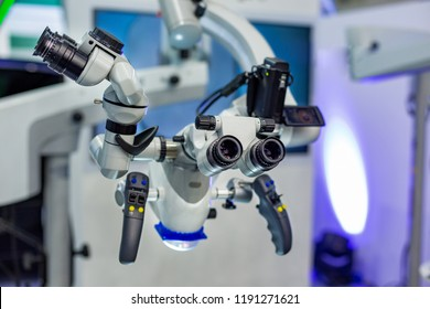 Dental microscope on the background of modern dentistry. Medical equipment. Dental operating microscope with rotary double binocular.