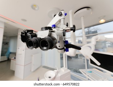 Dental microscope on the background of modern dentistry. Medical equipment