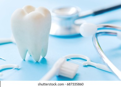 Dental model and dental equipment on blue background, concept image of dental background. dental hygiene background