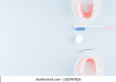 Dental model with dental equipment on white background in dental health care concept.