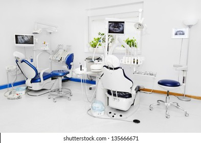 Dental office with blue dental chair