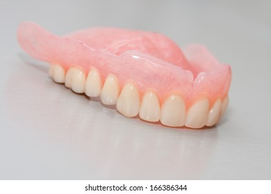 Dental prosthesis isolated in grey background
