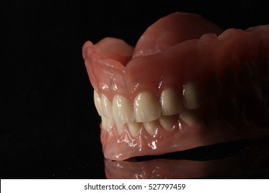 Dental prosthesis on dark background