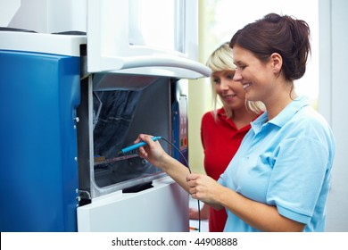 Dental technician scanning a chip for a CAM