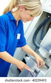 Dental technician working on a CAD CAM