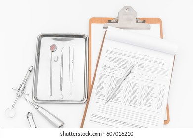 Dental tools, equipment and dental chart on white background.