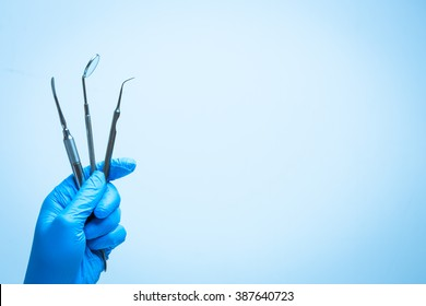 Dental tools in gloved hand