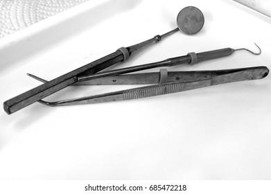 Dental tools: Tarter Scraper and Remover Set. Black and white retro. Copy space