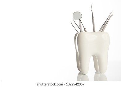 Dental tooth model with metal medical dentistry equipment tools for teeth dental care isolated on white background with copy space, close-up. Oral dental hygiene concept