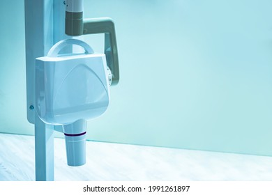 Dental x-ray equipment. Dentistry radiovisiograph on wall background. x-ray equipment for creating 3D images of oral cavity. X-ray equipment for scanning man oral cavity. Making 3D photo oral cavity
