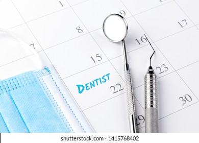 Dentist appointment in calendar and professional dental tools.- Image