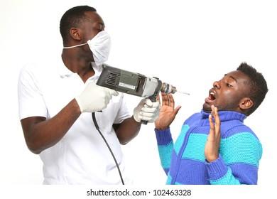dentist with borer