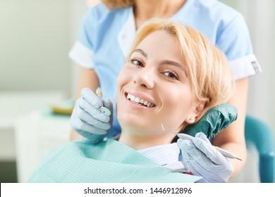 Dentist checks the teeth of a girl