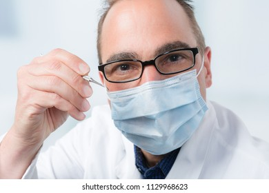 dentist with a dental instrument