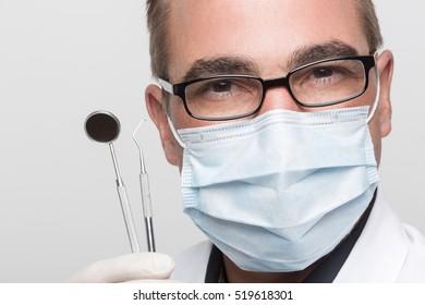 dentist with dental instruments