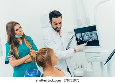 dentist doctor with the assistant in the clinic