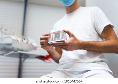 Dentist doctor holding teeth implant  model in his hands